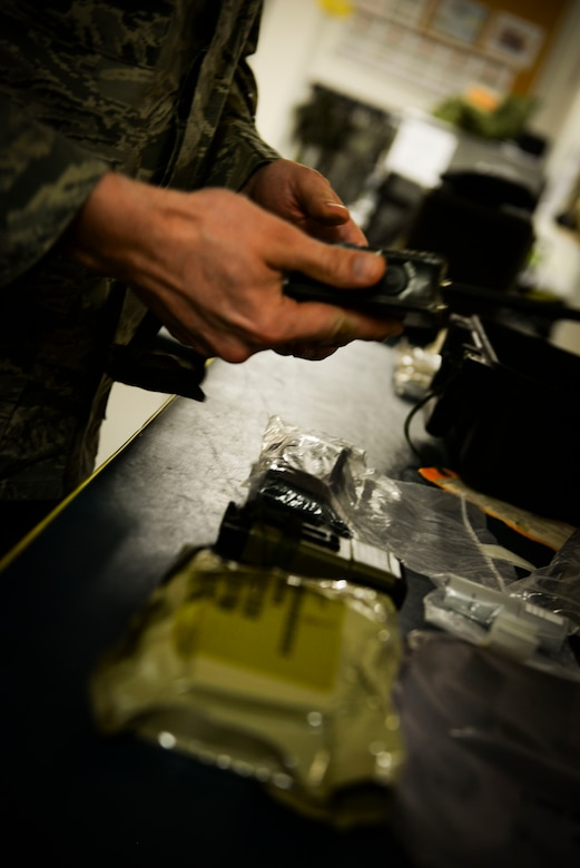A U.S. Airman from the 100th Operations Support Squadron aircrew flight equipment shop inspects the emergency kit box for the KC-135 Stratotanker making sure all certifications are up to date at RAF Mildenhall, England, April 24, 2018. The AFE shop has a variety of equipment to keep track of, from rubber rafts to life preservers. (U.S. Air Force photo by Airman 1st Class Alexandria Lee)