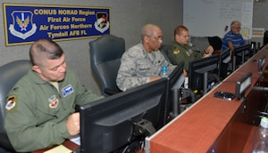 TYNDALL AIR FORCE BASE, Fla. - Maj. Gen. Leonard Isabelle Jr., (right) Air Forces Northern Joint Forces Air Component commander for  Ardent Sentry 18, a hurricane-response preparation exercise, readies for the morning briefing via teleconference here May 9. Beside him is Col. Timothy Williams, deputy director, AFNORTH Operations Directorate. (Air Force photo by Mary McHale)