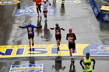 Arizona Air National Guard Master Sgt. Dan Martin, left, 161st Logistics Readiness Squadron NCO in charge of fuels operations, celebrates as he crosses the finish line at the 122nd annual Boston Marathon April 16, 2018. Martin completed this year's Boston Marathon in 3 hours, 25 minutes, 22 seconds. (U.S. Air National Guard/Courtesy Photo)