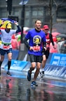 Arizona Air National Guard Master Sgt. Dan Martin, 161st Logistics Readiness Squadron NCO in charge of fuels operations, runs alongside other participants during the 122nd annual Boston Marathon April 16, 2018. Martin completed this year's Boston Marathon in 3 hours, 25 minutes, 22 seconds. (U.S. Air National Guard/Courtesy Photo)