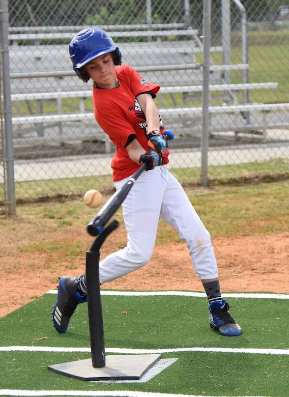 Maddox Cloutier, son of U.S. Air Force Master Sgt. Brian Cloutier, 558th Flying Training Squadron remotely piloted aircraft pilot training student, Joint Base San Antonio-Randolph Air Force Base, Texas, takes a swing during the Biloxi Shuckers Youth Baseball Clinic on the youth center baseball field at Keesler Air Force Base, Mississippi, May 5, 2018. The clinic provided hitting, pitching, base running and fielding instruction from members of the Biloxi Shuckers minor league baseball team. (U.S. Air Force photo by Kemberly Groue)