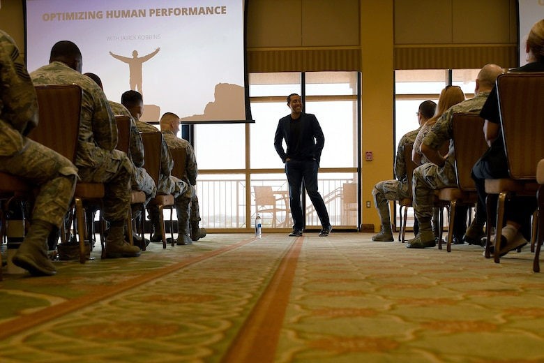 "Jairek Robbins, performance coach, speaks to Keesler personnel during a private mentoring session in the Bay Breeze Event Center at Keesler Air Force Base, Mississippi, May 7, 2018. Approximately 100 Keesler members signed up for ""The Complete Guide to Activating High Performance"" course, a 4-week online training course with weekly guided face-to-face discussions as well as a private mentoring session with Robbins. (U.S. Air Force photo by Airman 1st Class Suzie Plotnikov)"
