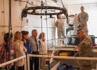 Staff Sgt. Adam Pruitt, 790th Maintenance Squadron missile maintenance technician topside instructor, shows a group of local educators the inside of a payload transport on F.E. Warren Air Force Base, Wyo., April 19, 2016. The educators teach and look after many of the children of on-base residents. (U.S. Air Force photo by Senior Airman Jason Wiese)