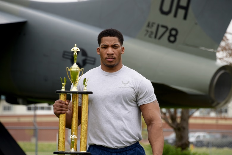 """Senior Airman Ervin Anderson, an administrative specialist with the 251st Cyberspace Engineering Installation Group, exemplifies the Air Force core value of """"excellence in all we do"""" through his impressive body building achievements."""