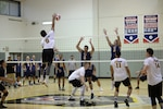 HURLBURT FIELD, Fla. –  Spc. Froydan DeLeon, with the Army Men's volleyball team, spikes the volleyball towards the Navy Men's defense. Elite U.S. military volleyball players from around the world compete for dominance at Hurlburt Field's Aderholt Fitness Center May 7-11, 2018 to determine the best of the best at the 2018 Armed Forces Volleyball Championship. Army, Navy (with Coast Guard) and Air Force teams squared off at the annual AFVC through three days of round-robin competition, to eventually crown the best men and women volleyball players in the military. U.S. Navy photo by Mass Communication Specialist 2nd Class John Benson (Released)