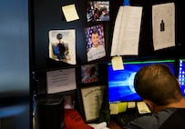 Officer Tim Bull, a Combat Arms Training and Maintenance instructor, does paperwork at his desk, April 26, 2018, at the CATM building on Patrick Air Force Base. Bull has a son, Gage, who is in the 5th grade. Bull did not overcome addiction on the first try, it took him four times to quit, each time bouncing back better and better in the process. Bull demonstrates perseverance, hard work, and becoming a role model not only to his son, but others as well. (U.S. Air Force photo by Airman 1st Class Dalton Williams)