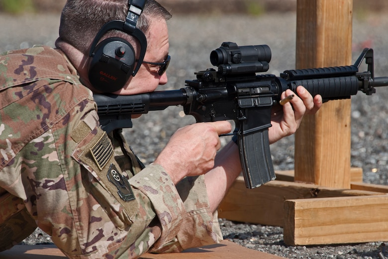 Chief Master Sgt. James Loper, 10th Air Force Command Chief, qualifies on the M-4 rifle