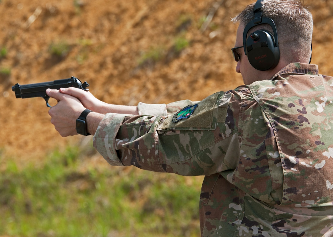 Chief Master Sgt. James Loper, 10th Air Force Command Chief, qualifies on the M-9 pistol May 3, 2018 during his four-day visit to Duke Field, Florida