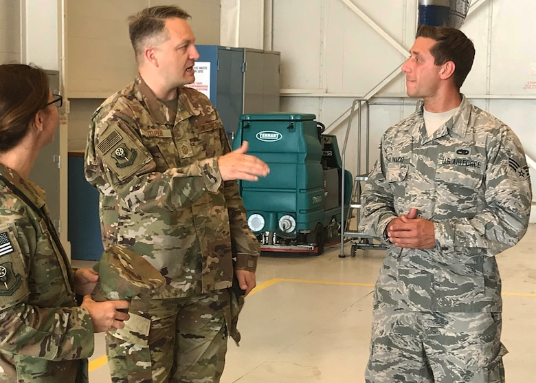 Chief Master Sgt. James Loper, 10th Air Force Command Chief, meets Senior Airman Kerstan Chojnacki, 919th Special Operations Aircraft Maintenance Squadron