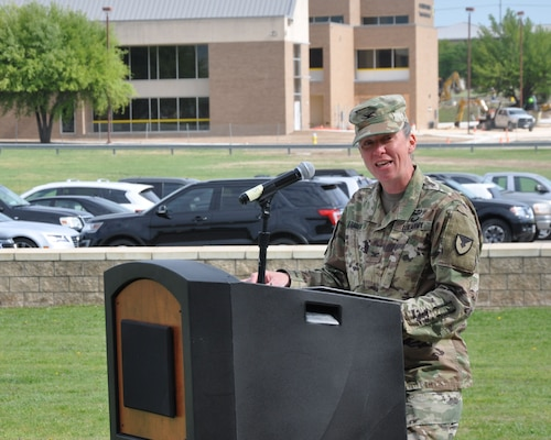 Col. Lynda Armer addresses members of the 418th Contracting Support Brigade, military leaders, families and friends during an uncasing ceremony April 20 at Fort Hood, Texas. The uncasing of organizational colors signals the return from deployment to Afghanistan for the unit. Armer is the 418th CSB commander.