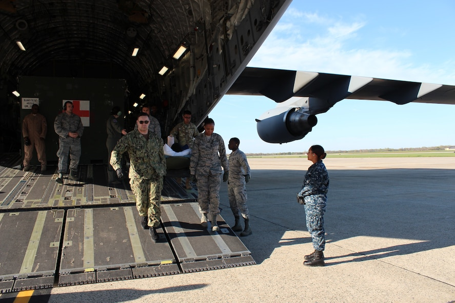 Service members unload patients during an aeromedical evacuation from Ramstein Air Base, Germany, to Joint Base Andrews, Md., April 26, 2018. Missions transport sick or injured patients to the U.S. from around the world. (U.S. Air Force photo by Karina Luis)