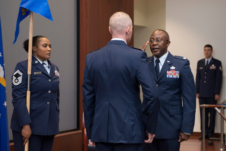 Lt. Col. Christopher Hall, 709th Support Squadron commander, renders a salute to Col. Richard Mendez, 709th Support Group commander, after taking command of the newly-formed squadron within the Air Force Technical Applications Center, Patrick AFB, Fla.  Also pictured (left) is Senior Master Sgt. Shannon S. Harris, 709th SPTS superintendent.  (U.S. Air Force photo by Matthew S. Jurgens)
