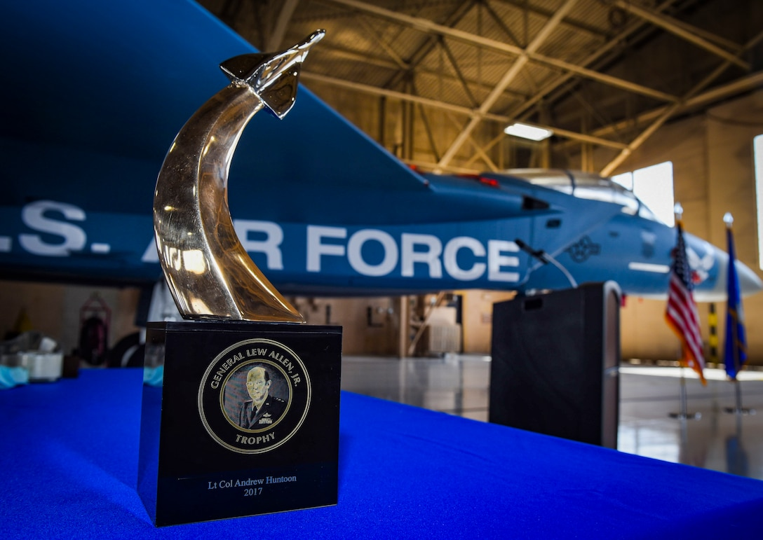 The Gen. Lew Allen Award sits in front of an F-15 Eagle fighter jet during a ceremony at Nellis Air Force Base, Nevada, May 2, 2018. The award recognizes the outstanding performances of Air Force personnel involved in aircraft sortie generation and mission execution. (U.S. Air Force photo by Airman 1st Class Andrew D. Sarver)