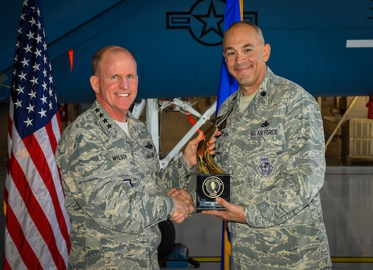 Air Force Vice Chief of Staff Gen. Stephen W. Wilson presents the Gen. Lew Allen Jr. Award to Lt. Col. Andrew Huntoon, 57th Maintenance Group deputy commander, at Nellis Air Force Base, Nevada, May 2, 2018. Huntoon was one of four recipients for 2017. (U.S. Air Force photo by Airman 1st Class Andrew D. Sarver)