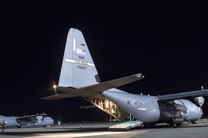 Airmen assigned to the 746th Expeditionary Airlift Squadron check bundles of cargo aboard a C-130J Super Hercules at Bagram Air Field.
