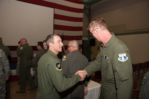 Maj. Gen. Ronald B. Miller, 10th Air Force Commander, congratulates members of the 920th Rescue Wing.