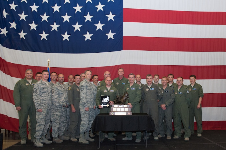 Maj. Gen. Ronald B. Miller, 10th Air Force Commander, poses with members of the 920th Rescue Wing after presenting them with the Power and Vigilance award.