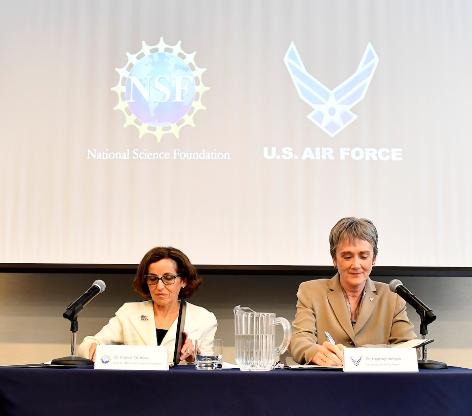 Secretary of the Air Force Heather Wilson and the National Science Foundation Director France Córdova sign a letter of intent in Washington, D.C., May 9, 2018. The letter of intent initiates a strategic partnership focused on research in four areas of common interest: space operations and geosciences, advanced material sciences, information and data sciences, and workforce and processes. (U.S. Air Force photo by Staff Sgt. Rusty Frank)