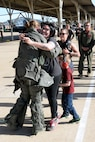 Capt. Kristin Wolfe, 34th Fighter Squadron, is welcomed home by family upon returning from deployment, May 5, 2018, at Hill Air Force Base, Utah. (U.S. Air Force photo by Todd Cromar)