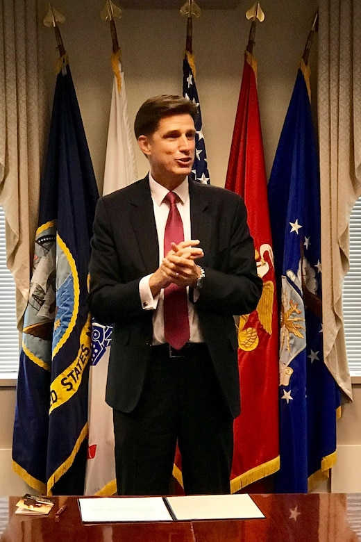 Dana Deasy addresses the gathering of his wife, staff and colleagues at the Pentagon's Nunn-Lugar conference room following his swearing-in ceremony as the Defense Department's chief information officer.