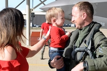 Lt. Col. Matthew Olsen, 388th Fighter Wing, is greeted by his wife and son, Allison and Bryce, upon returning from deployment, May 5, 2018, at Hill Air Force Base, Utah. (U.S. Air Force photo by Todd Cromar)