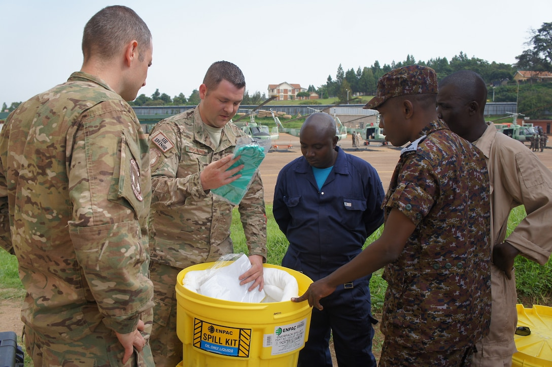 Master Sgt. James Hoskins, 818th Mobility Support Advisory Squadron air advisor, instructs basic fuels management principles and environmental safety precautions to Ugandan People's Defense Air Force as part of a mobile training team mission in Entebbe, Uganda, Dec. 14, 2017. The 818th MSAS last conducted a traveling contact team with the UPDAF in December 2016 whereby representatives of the U.S. Air Force and the UPDAF exchanged best practices focused on principles of petroleum, oil, and lubricants. This engagement sought to further the discussion with hands-on training in the hazards of petroleum products and prevention, laboratory analysis, and the fuels safety servicing zone. (Courtesy photo)