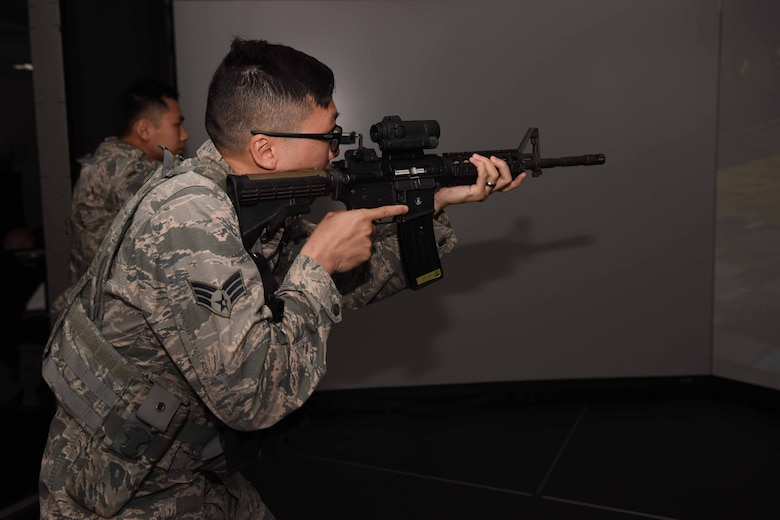 Members of the 30th Security Forces Squadron participate in the Virtual Reality Simulation to practice real life scenarios on May 3, 2018 at Vandenberg Air Force Base, Calif. Virtual Reality Simulation is a part of 30th SFS's month of training and inside the simulation a team of two will be given scenarios which they must react according to procedures to pass. (U.S. Air Force photo by Airman Aubree Milks/Released)