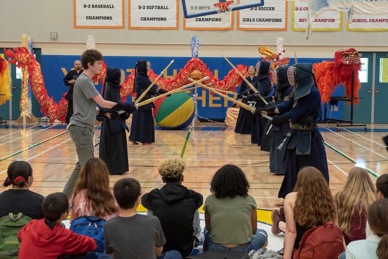 Volunteers demonstrate a set of Kendo exercises known as kata for students as part of the National Asian American and Pacific Islander Heritage Celebration at Yokota High School, Yokota Air Base, Japan, May 3, 2018.