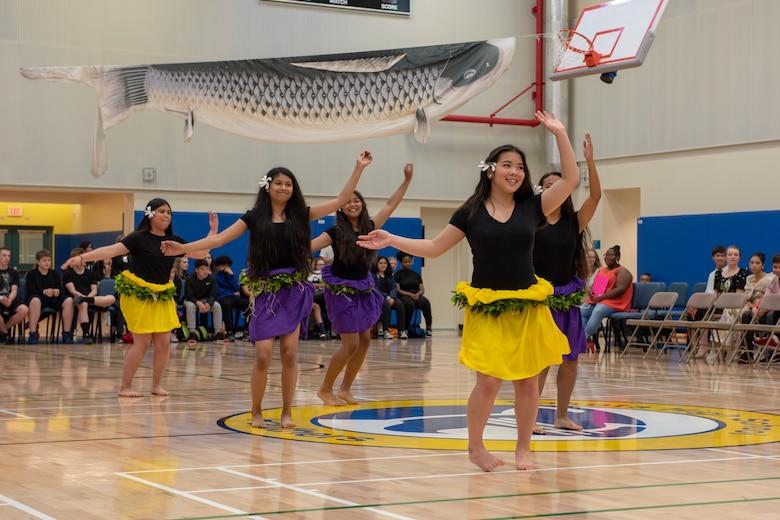 Students perform the Hawaiian dance Te-Hiva as part of the National Asian American and Pacific Islander Heritage Celebration at Yokota High School, Yokota Air Base, Japan, May 3, 2018.
