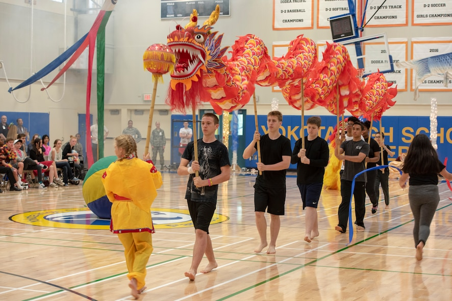 Students perform the Chinese dragon dance as part of the National Asian American and Pacific Islander Heritage Celebration at Yokota High School, Yokota Air Base, Japan, May 3, 2018.