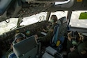 Capt. Cari Piha, Maj. Toni Merhar, and Maj. Jamilee Gunnels, 535th Airlift Squadron C-17 Globemaster III pilots, perform an in-flight refueling mission, Joint Base Pearl Harbor-Hickam, Hawaii, April 25, 2018. The aircrew featured mothers to celebrate mothers who serve in the military and to highlight challenges Airmen face when balancing families and career. (U.S. Air Force photo by Tech. Sgt. Heather Redman)