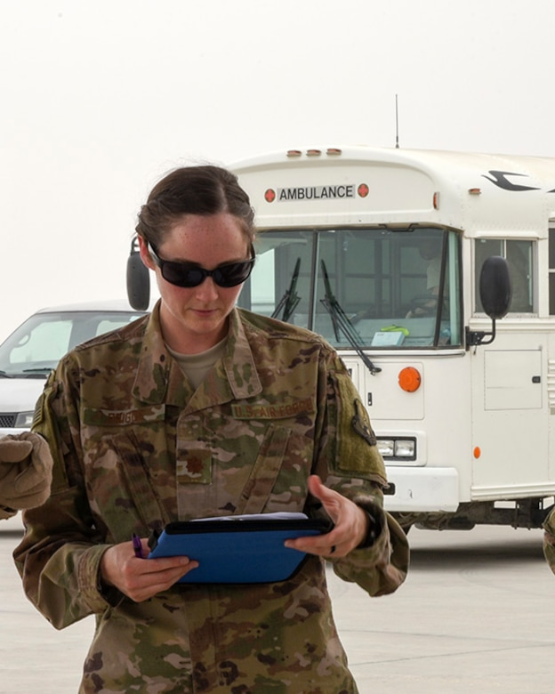 Maj. Kelly Prigge, officer in charge of the En Route Patient Staging Flight (ERPSF), reviews patient information prior to transporting the patients to a larger treatment facility at Al Udeid Air Base, Qatar on May 5, 2018. The ERPSF plays a vital role in transporting patients from various deployed location and ensuring their safe and stable transport to a facility that can support the sustained injuries. (U.S. Air Force photo by Staff Sgt. Enjoli Saunders)