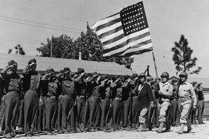 Members of the 442nd Regimental Combat Team salute the American flag.