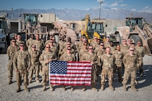 Airmen from the 1st Civil Engineer Group's 577th Expeditionary Prime Base Engineer Emergency Force Squadron pose for a group photo at Bagram Airfield, Afghanistan, May 4, 2018. Separate from traditional civil engineer units, the members of the 1st ECEG perform construction and repair in high-risk environments all across the area of operations. (U.S. Air Force photo by Staff Sgt. Joshua Horton)