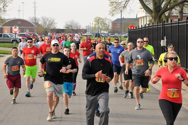 "Members of Team Selfridge participate in the second annual, ""Running of the Hawgs,"" event here on May 6, 2018. The race, organized by the 127th Maintenance Group here, invited civilians and servicemembers to compete in either a 5k run or a mile-long walk on a measured course, on base. Proceeds from the event were donated to the Adopt-A-Family organization. (U.S. Air Force photo by Senior Airman Ryan Zeski)"