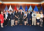 DLA Energy Acting Commander Guy Beougher, center, and DLA Energy Supplier Operations Director Gabby Earhardt, far left, pose for a group photo with employees that were recognized for completing their certification during Defense Acquisition Workforce Improvement Act ceremony May 3. Photo by DLA Installation Operations Shane Potter