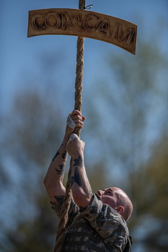 Staff Sgt. Corban Lundborg, assigned to 4th Combat Camera Squadron, climbs a rope during the obstacle course portion of the 2018 SPC Hilda I. Clayton Best Combat Camera Competition at Marine Corps Base Quantico, Va., May 1, 2018. The competition is an annual event open to all branches of the military, it's hosted by the 55th Signal Company (Combat Camera) in order to test the technical and tactical proficiencies of Defense Department combat photographers. (U.S. Army photo by Staff Sgt. Pablo N. Piedra)