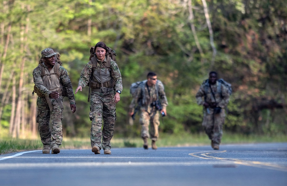 Airman 1st Class Franklin Harris (left) and Senior Airman Maygan Straight, both assigned to 1st Combat Camera Squadron, conduct the 10-mile road march part of the 2018 SPC Hilda I. Clayton Best Combat Camera Competition at Marine Corps Base Quantico, Va., May 3, 2018. The competition is an annual event open to all branches of the military, it's hosted by the 55th Signal Company (Combat Camera) in order to test the technical and tactical proficiencies of Defense Department combat photographers. (U.S. Army photo by Staff Sgt. Pablo N. Piedra)