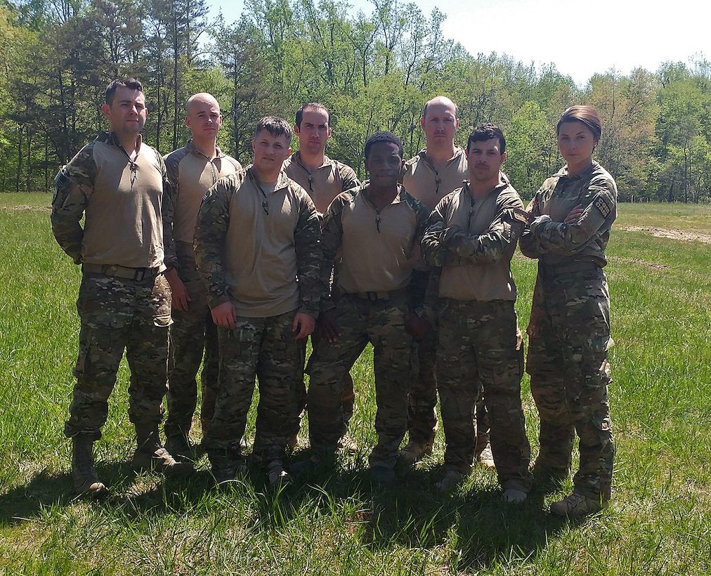 Airmen from the 1st Combat Camera Squadron and 4th Combat Camera Squadron, pose for a photo following the completion of a 10-mile road march at the 2018 SPC Hilda I. Clayton Best Combat Camera Competition at Marine Corps Base Quantico, Va., May 3, 2018. The competition is an annual event open to all branches of the military, it's hosted by the 55th Signal Company (Combat Camera) in order to test the technical and tactical proficiencies of Defense Department combat photographers. (U.S. Air Force photo by Maj. Zach Anderson)