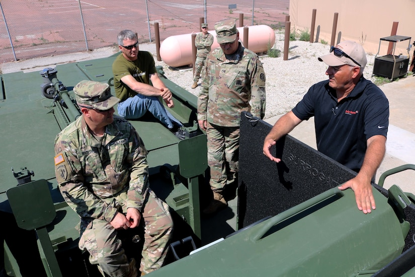 Dan Wassum, Engineer Supervisor for Birdon America briefs instructors from the 102d Training Division on the M30 Bridge Erection boat capabilities and parts.