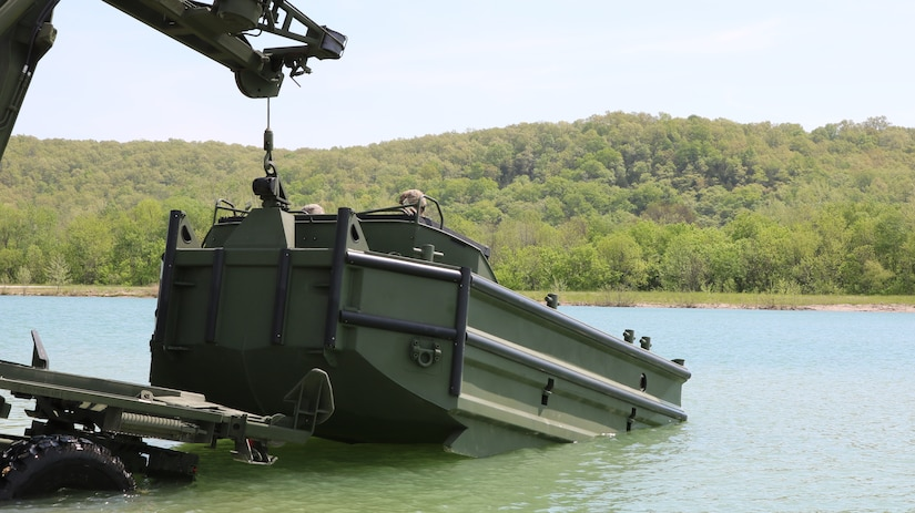 The M30 Bridge Erection Boat is launched into the water during  new equipment operator training at Fort Leonard Wood, Mo.