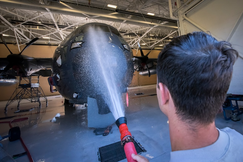 Senior Airmen Aaron Brewer, 71st Aircraft Maintenance Unit (AMU) crew chief, uses a power washer to clean an HC-130J Combat King II, May 7, 2018, at Moody Air Force Base, Ga. Upon return from a deployment or every 180 days, HC-130's are thoroughly cleaned and inspected as part of routine upkeep and to ensure its respective components are in working condition. (U.S. Air Force photo by Airman 1st Class Eugene Oliver)