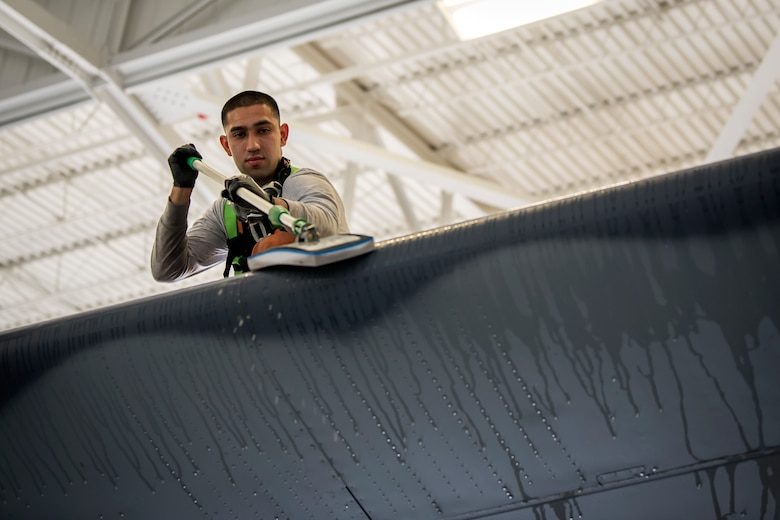 Airman 1st Class Jesse Orosco, 71st Aircraft Maintenance Unit (AMU) crew chief, uses a magic eraser to clean the tail fin of an HC-130J Combat King II, May 7, 2018, at Moody Air Force Base, Ga. Upon return from a deployment or every 180 days, HC-130's are thoroughly cleaned and inspected as part of routine upkeep and to ensure its respective components are in working condition. (U.S. Air Force photo by Airman 1st Class Eugene Oliver)
