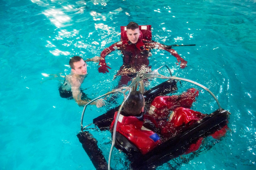 Coast Guard Academy cadets test out their new rescue basket design