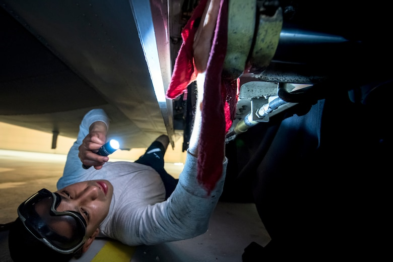 Airman 1st Class Jesse Orosco, 71st Aircraft Maintenance Unit (AMU) crew chief, uses a rag to clean the internal component to the landing gear of an HC-130J Combat King II, May 8, 2018, at Moody Air Force Base, Ga. Upon return from a deployment or every 180 days, HC-130's are thoroughly cleaned and inspected as part of routine upkeep and to ensure its respective components are in working condition. (U.S. Air Force photo by Airman 1st Class Eugene Oliver)