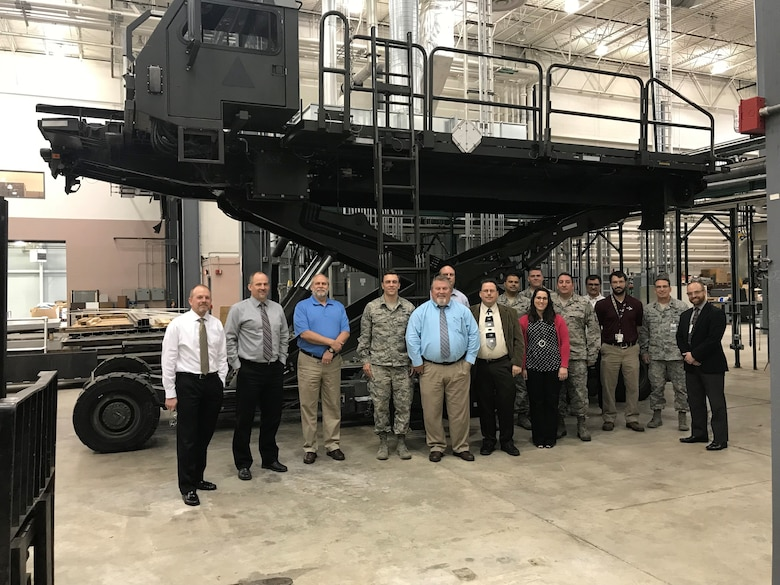 The Halvorsen 25K Loader is a rapidly-deployable, high-reach mechanized aircraft loader that can transport and lift up to 25,000 pounds of cargo and load it onto military aircraft. Members of the Halvorsen team visit Concurrent Technologies Corporation.