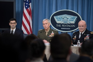 Defense officials brief reporters at the Pentagon.