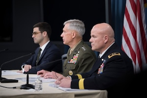 From left, Assistant Secretary of Defense for International Security Affairs Robert S. Karem; Marine Corps Gen. Thomas D. Waldhauser, commander of U.S. Africa Command; and Army Maj. Gen. Roger L. Cloutier Jr., Africom's chief of staff and the investigating officer for the Army Regulation 15-6 investigation into the Oct. 4, 2017, attack in Niger, brief the Pentagon press corps on the results of the investigation, May 10, 2018. DoD photo by Navy Petty Officer 1st Class Kathryn E. Holm