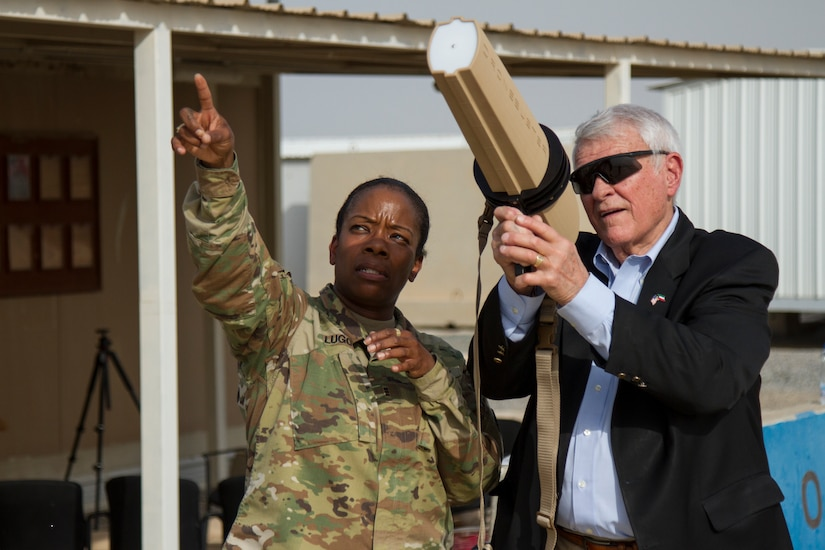 Chief Warrant Officer 3 Edna C. Lugo, command and control systems technician, Central Command, shows U.S. Representative John R. Carter, Texas, some counter unmanned aerial systems equipment and techniques, Camp Arifjan, Kuwait, May 4, 2018. U.S. Representatives John R. Carter and Roger Williams from Texas visited U.S. servicemembers in the middle east as part of a congressional delegation.