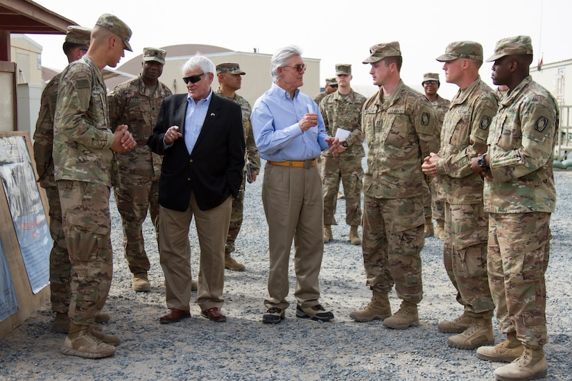 U.S. Representatives John R. Carter and Roger Williams, Texas, speak with Soldiers with 1-62 Air Defense Artillery, Camp Arifjan, Kuwait, May 4, 2018. U.S. Representatives John R. Carter and Roger Williams from Texas visited U.S. servicemembers in the middle east as part of a congressional delegation.